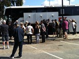West Coast Eagles fans prepare to board the coach from Perth to Melbourne for the AFL Grand Final