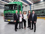 Steve Lotter (left) delivers the milestone truck.