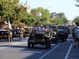 Jeeps lead a parade of 200 military vehicles down Sanger Street, Corowa.