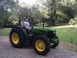 Lucky winner Bill Crew with his brand spanking new John Deere workhorse.