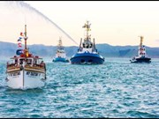 The Takitimu leads Eastland Port's new tug boat, the Waimata, into the harbour.