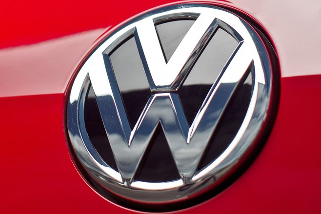 Volkswagen badge on Red Golf TDI