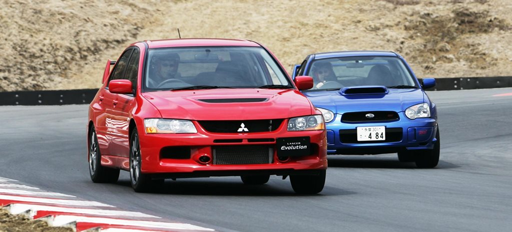 2005 Mitsubishi Lancer Evolution IX vs Subaru Impreza WRX STi comparison
