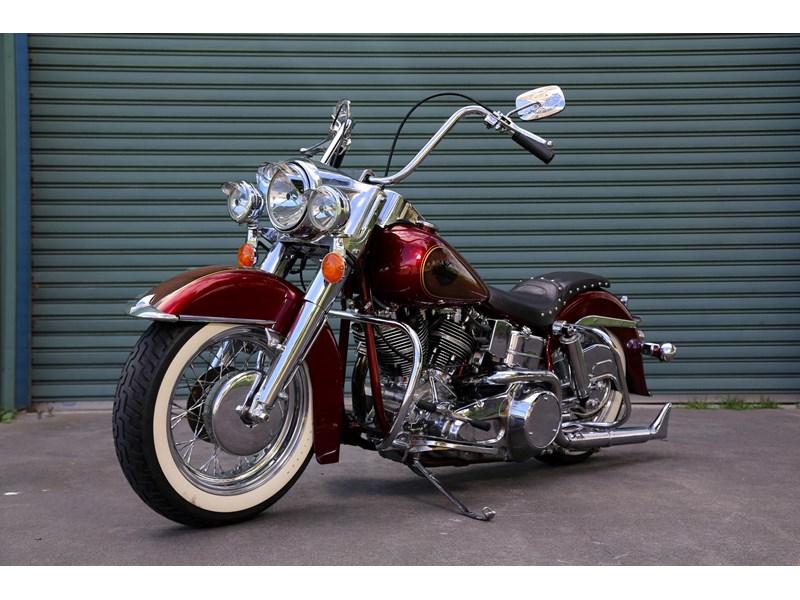 http://d3lp4xedbqa8a5.cloudfront.net/imagegen/p/800/600/s3/digital-cougar-assets/momoads/2014/10/06/11/1970_Harley_Davidson_FLH_red_f45ls.jpg