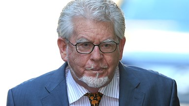 Rolf Harris admits being 'touchy-feely'