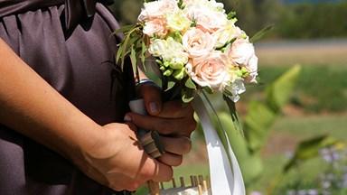 Bridesmaid conceals contractions at sister's wedding