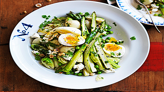 Warm green salad with soft eggs and hazelnut dressing