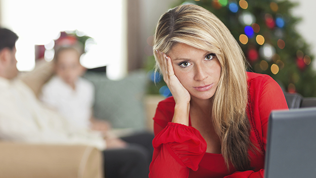 Woman feeling stressed at Christmas time.