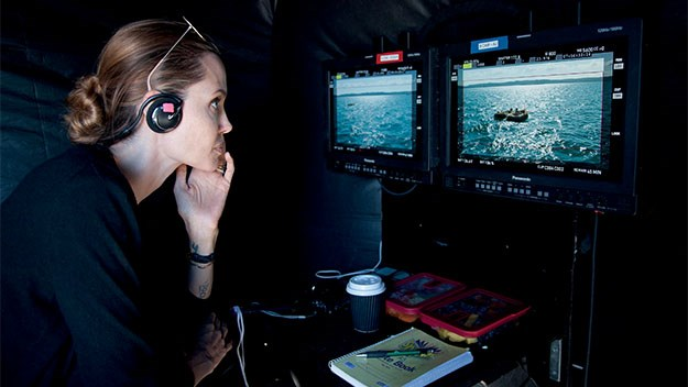 Angelina in the director's chair of her film, Unbroken. Picture: Universal Pictures