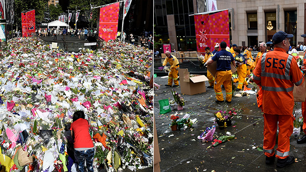 Flowers in Martin Place being clear away on Tuesday.