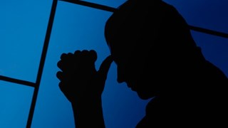 Sad man with blue background
