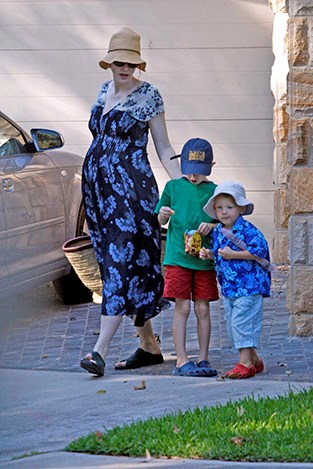 Cate is pictured here pregnant with her last son, Ignatius on a fun beach trip with her sons.