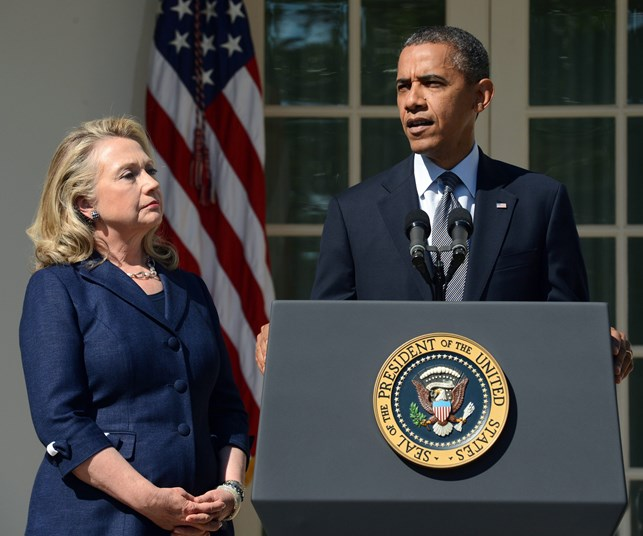Former US Secretary of State Hillary Clinton and US President Barack Obama. PHOTO: Getty.