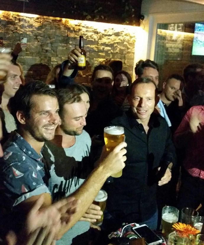 Tony Abbott skolls a beer at Sydney pub