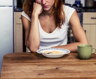 Woman unhappy eating cereal