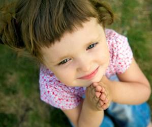 little girl praying Thinkstock