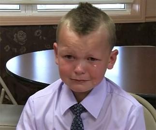 Heroic boy saves dad's life