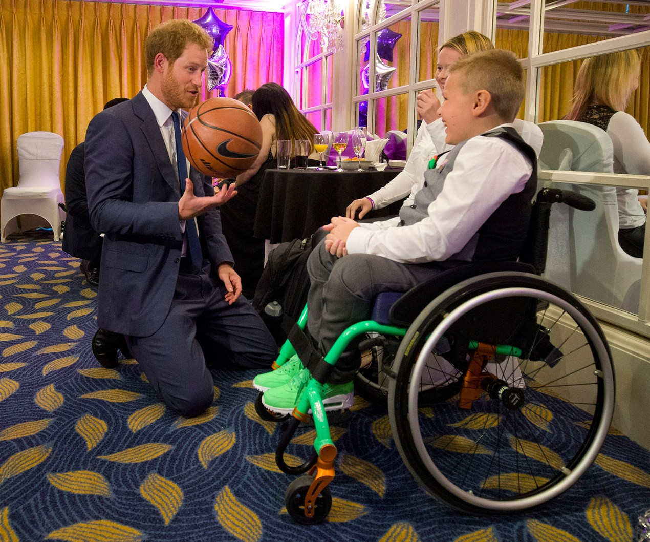 Prince of Hearts: Harry brings smiles to sick kids