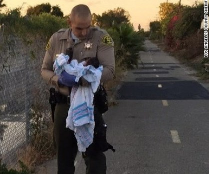 Baby found 'buried alive' bedside bike path