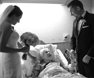 Wedding couple visit grandma in hospital