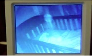 Mum films ghost baby in cot next to sleeping daughter