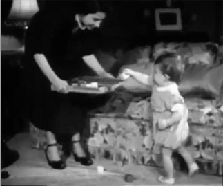 Unseen footage of the Queen and baby Charles playing