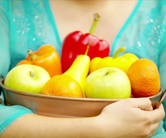 woman holding fruit bowl