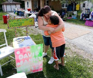 Boy sets up lemonade stand to pay for own adoption
