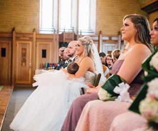 Bride breastfeeds during wedding ceremony