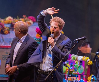Prince Harry joins Coldplay on stage