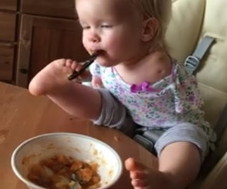 Inspiring little girl with no arms teaches herself to eat with her feet