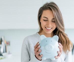 Woman saving money piggybank