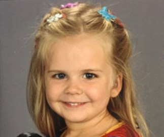 Toddler dresses herself for school photo, goes viral