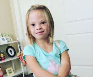 See this 7-year-old cutie celebrate having Down syndrome