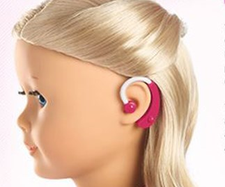 Doll with a hearing aid