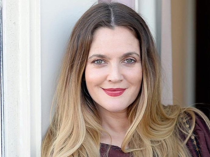 Drew Barrymore shares a makeup-free selfie while working out at the gym