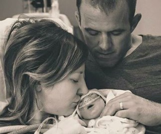 Abbey and Robert Ahern with their baby girl Annie.