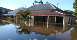 A house is partially submerged during the Queensland floods, January 2011. (Credit: Getty Images)