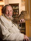 Warren Bonython holds his boot in 2005, a symbol of his passion for bushwalking. (Credit: Randy Larcombe)