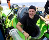 James Cameron emegers to cheers after the world's deepest solo dive. (Credit: AAP)
