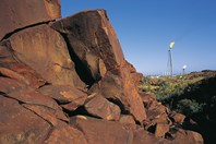 Burrup Peninsula rock art, with industry looming in the background. (Credit: David Dare Parker/Australian Geographic)