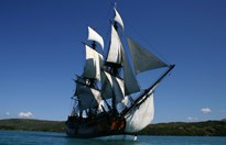 The Endeavour replica at full sail in the Whitsundays. (Credit: Ellie Dent/AAP)