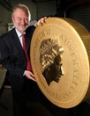 Perth Mint Chief Executive Officer, Ed Harbuz, with the world's biggest, heaviest, and most valuable gold bullion coin.
