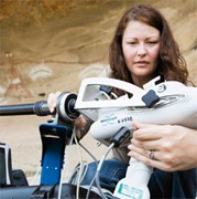 Jillian sets up the X-ray gun, ready  to non-invasively analyse Aboriginal rock art at Biamie Cave, NSW. (Credit: Ben Ey)