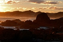 Gippsland, Victoria. Granite rocks are lit up by the sunset at West Point, near Capte Conran. (Credit: Don Fuchs