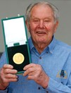Tom Kruse with his Australian Geographic Society Lifetime of Adventure Award in 2003. (Credit: J. Morgan)