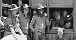 The 2/7th Infantry Battalion, including Sgt Reg Saunders, wait at a troop train in QLD, 1943. (Credit: Australian War Memorial)