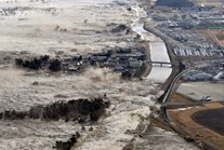 A tsunami hits the north-east coast of Japan after a magnitude 9.0 earthquake on March 11, 2011. (AAP Photo/Kyodo News)