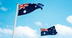 Two Australian flags flapping in the breeze (Photo: Getty/Tobias Titz).