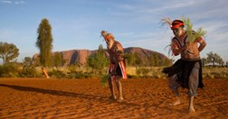 Anangu men dance to celebrate the opening of Uluru's Talinguru sunrise viewing platform (Uluru Kata-Tjuta NP).